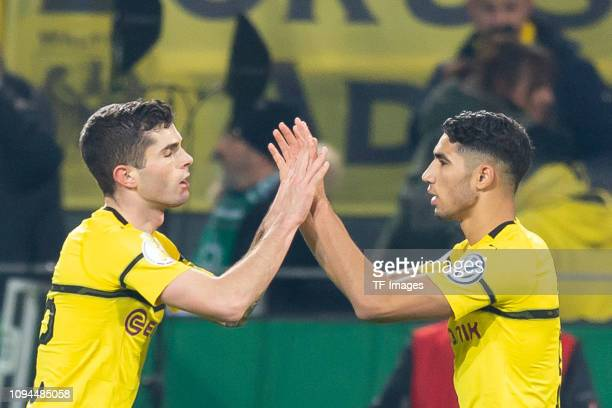 Christian Pulisic of Borussia Dortmund celebrates after scoring his team's second goal with Achraf Hakimi of Borussia Dortmund during the DFB Cup...
