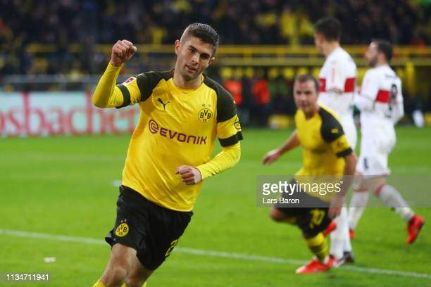 Christian Pulisic of Borussia Dortmund celebrates after scoring his team's third goal during the Bundesliga match between Borussia Dortmund and VfB...