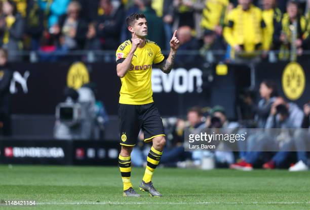 Christian Pulisic of Borussia Dortmund celebrates after scoring his team's first goal during the Bundesliga match between Borussia Dortmund and...
