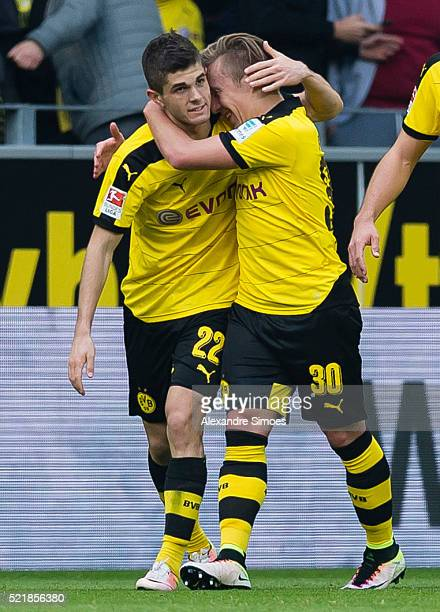 Christian Pulisic of Borussia Dortmund celebrates after scoring the opening goal together with his team mate Felix Passlack during the Bundesliga...