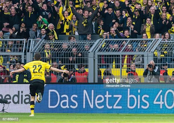 Christian Pulisic of Borussia Dortmund celebrates after scoring the opening goal during the Bundesliga match between Borussia Dortmund and Hamburger...
