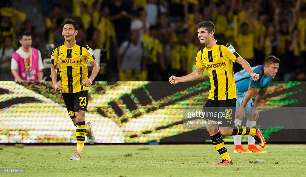 Christian Pulisic of Borussia Dortmund celebrates after scoring the goal to the 1:1 during the International Champions Cup China match between Manchester City and Borussia Dortmund during Borussia Dortmund's Summer Asia Tour 2016 on July 28, 2016 in Shenzhen, China.