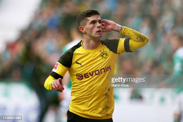 Christian Pulisic of Borussia Dortmund celebrates scoring the opening goal during the Bundesliga match between SV Werder Bremen and Borussia Dortmund...