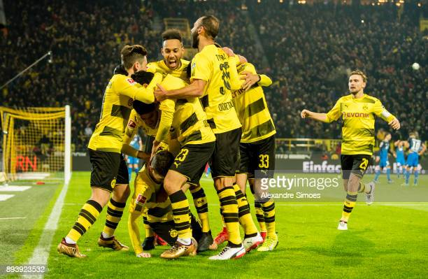 Christian Pulisic of Borussia Dortmund celebrates scoring the winning goal to the 21 with his team mates during the Bundesliga match between Borussia...
