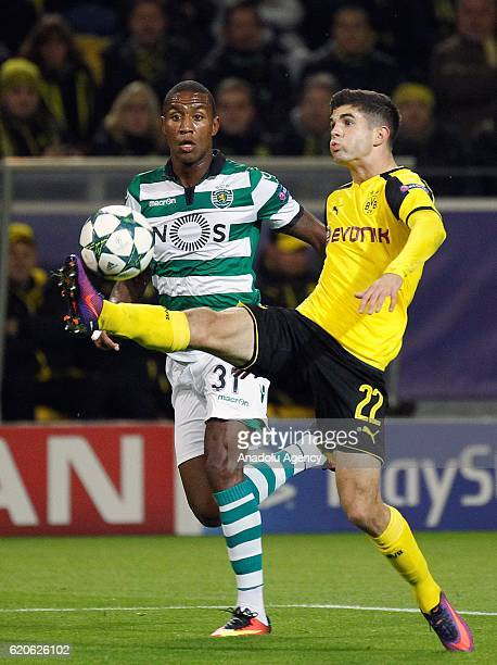 Christian Pulisic of Borussia Dortmund challenges with Marvin Zeegelaar of Sporting Lisbon during the UEFA Champions League Group F football match...