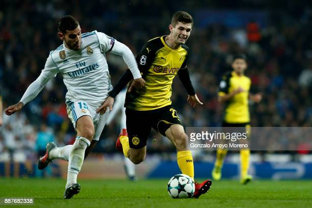 Christian Pulisic of Borussia Dortmund competes for the ball with Theo Hernandez during the UEFA Champions League group H match between Real Madrid...