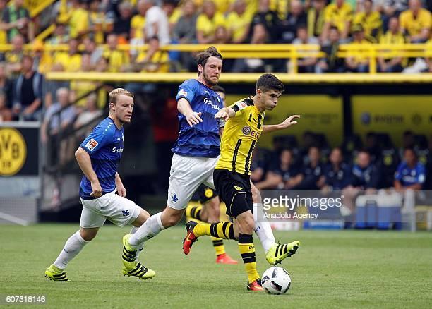 Christian Pulisic of Borussia Dortmund in action against Peter Niemeyer of SV Darmstadt 98 during Bundesliga soccer match between Borussia Dortmund...