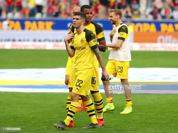 Christian Pulisic of Borussia Dortmund Manuel Akanji of Borussia Dortmund and Marcel Schmelzer of Borussia Dortmund celebrate after winning the...