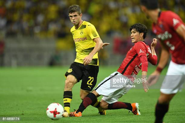 Christian Pulisic of Borussia Dortmund passes the ball during the preseason friendly match between Urawa Red Diamonds and Borussia Dortmund at...