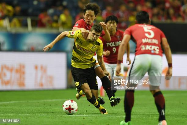 Christian Pulisic of Borussia Dortmund runs with the ball during the preseason friendly match between Urawa Red Diamonds and Borussia Dortmund at...