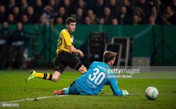Christian Pulisic of Borussia Dortmund scores the opening goal during the DFB Cup Quarter Final match between Sportfreunde Lotte and Borussia...