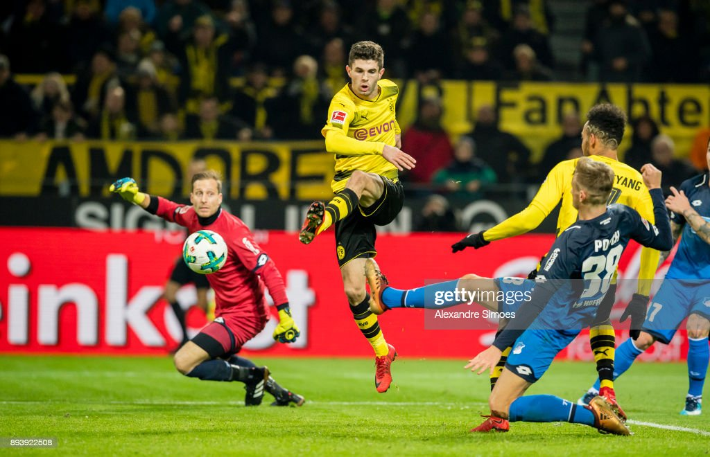 Christian Pulisic of Borussia Dortmund scores the winning goal to the 2:1 during the Bundesliga match between Borussia Dortmund and SG 1899 Hoffenheim at the Signal Iduna Park on December 16, 2017 in Dortmund, Germany.