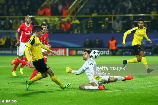 Christian Pulisic of Borussia Dortmund shoots and scores hot teams second goal during the UEFA Champions League Round of 16 second leg match between...
