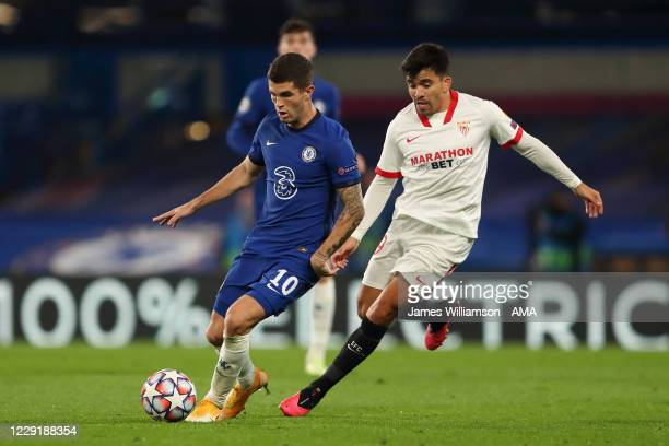Christian Pulisic of Chelsea and Marcos Acuna of Sevilla during the UEFA Champions League Group E stage match between Chelsea FC and FC Sevilla at...