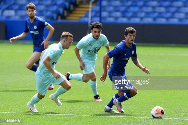 Christian Pulisic of Chelsea and Todd Kane of QPR during a friendly match between Chelsea and Queens Park Rangers at Stamford Bridge on June 14 2020...