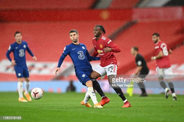 Christian Pulisic of Chelsea battles for possession with Aaron WanBissaka of Manchester United during the Premier League match between Manchester...