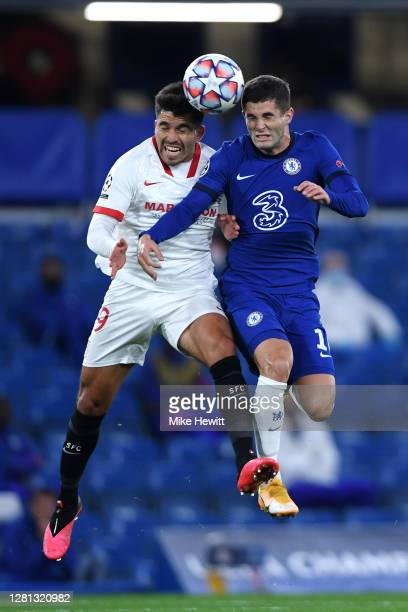 Christian Pulisic of Chelsea battles for possession with Marcos Acuna of Sevilla during the UEFA Champions League Group E stage match between Chelsea...