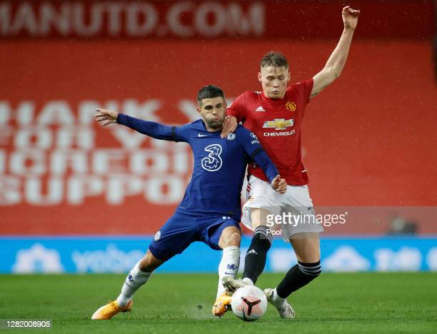 Christian Pulisic of Chelsea battles for possession with Scott McTominay of Manchester United during the Premier League match between Manchester...