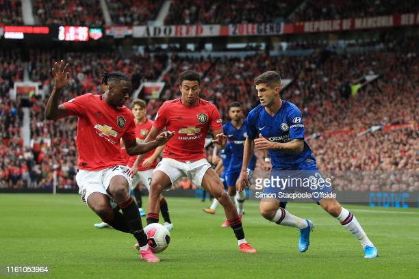 Christian Pulisic of Chelsea battles with Aaron WanBissaka of Man Utd and Jesse Lingard of Man Utd during the Premier League match between Manchester...