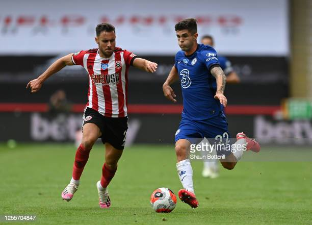 Christian Pulisic of Chelsea breaks away from George Baldock of Sheffield United during the Premier League match between Sheffield United and Chelsea...