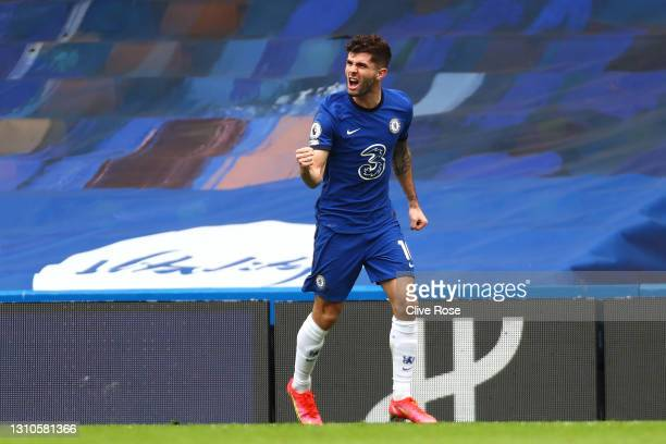 Christian Pulisic of Chelsea celebrates after scoring their team's first goal during the Premier League match between Chelsea and West Bromwich...