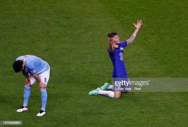 Christian Pulisic of Chelsea celebrates as Ilkay Guendogan of Manchester City looks dejected following the UEFA Champions League Final between...
