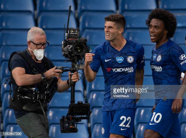 Christian Pulisic of Chelsea celebrates scoring the first goal of the game with Willian as a BT Sport cameraman with a steadicam camera films the...