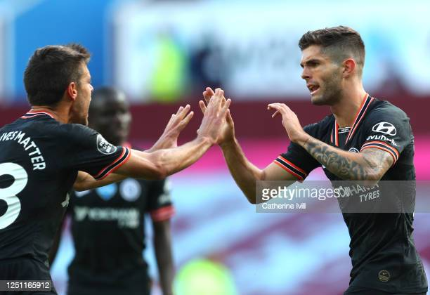 Christian Pulisic of Chelsea celebrates with Cesar Azpilicueta of Chelsea after he scores his teams first goal during the Premier League match...