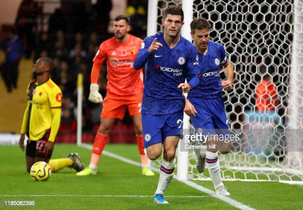 Christian Pulisic of Chelsea celebrates with teammate Cesar Azpilicueta after scoring his team's second goal during the Premier League match between...