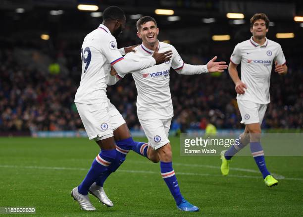 Christian Pulisic of Chelsea celebrates with teammate Fikayo Tomori after scoring his team's third goal during the Premier League match between...