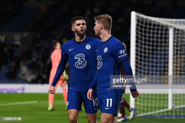 Christian Pulisic of Chelsea celebrates with teammate Timo Werner after scoring their team's third goal during the Premier League match between...