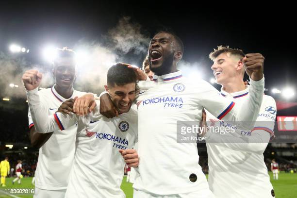Christian Pulisic of Chelsea celebrates with teammates after scoring his team's third goal during the Premier League match between Burnley FC and...