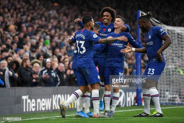 Christian Pulisic of Chelsea celebrates with teammates after scoring his team's second goal during the Premier League match between Chelsea FC and...