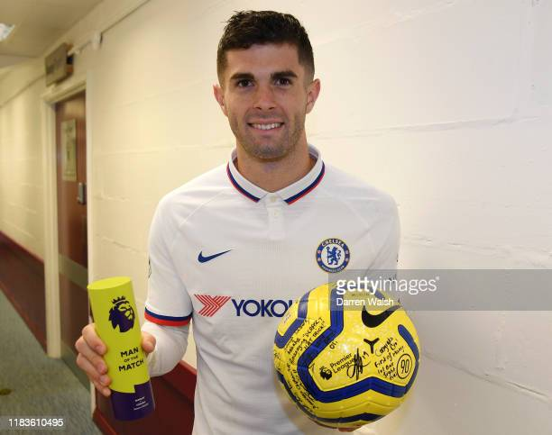 Christian Pulisic of Chelsea collects the match ball and the Man of the Match award following his hatrick during the Premier League match between...