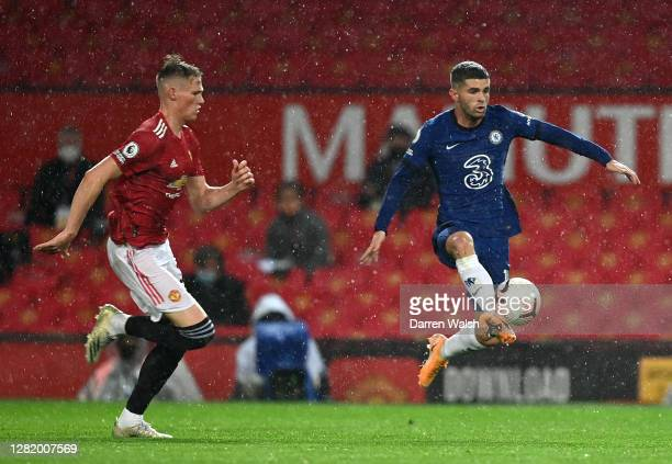 Christian Pulisic of Chelsea controls the ball under pressure form Scott McTominay of Manchester United during the Premier League match between...