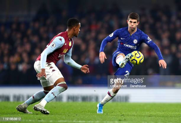 Christian Pulisic of Chelsea FC and Ezro Konsa of Aston Villa in action during the Premier League match between Chelsea FC and Aston Villa at...