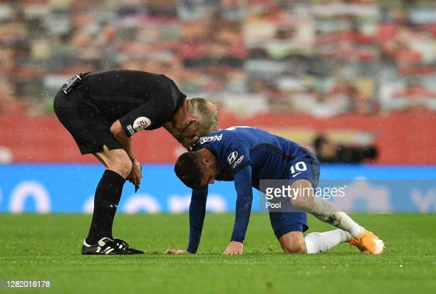 Christian Pulisic of Chelsea goes down injured during the Premier League match between Manchester United and Chelsea at Old Trafford on October 24...