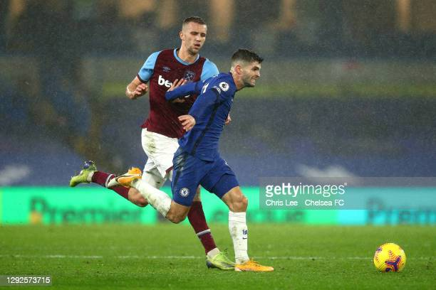 Christian Pulisic of Chelsea holds of Tomas Soucek of West Ham during the Premier League match between Chelsea and West Ham United at Stamford Bridge...