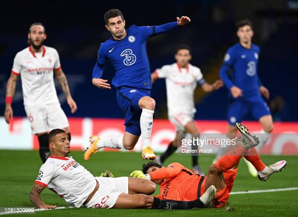 Christian Pulisic of Chelsea is challenged by Diego Carlos of Sevilla during the UEFA Champions League Group E stage match between Chelsea FC and FC...