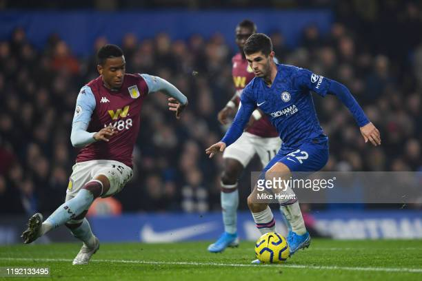 Christian Pulisic of Chelsea is challenged by Ezri Konsa of Aston Villa during the Premier League match between Chelsea FC and Aston Villa at...