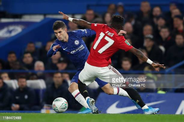 Christian Pulisic of Chelsea is challenged by Fred of Manchester United during the Carabao Cup Round of 16 match between Chelsea and Manchester...
