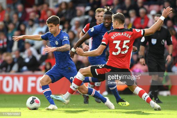 Christian Pulisic of Chelsea is challenged by Jan Bednarek of Southampton during the Premier League match between Southampton FC and Chelsea FC at St...