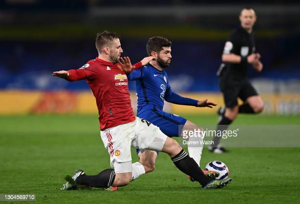 Christian Pulisic of Chelsea is challenged by Luke Shaw of Manchester United during the Premier League match between Chelsea and Manchester United at...