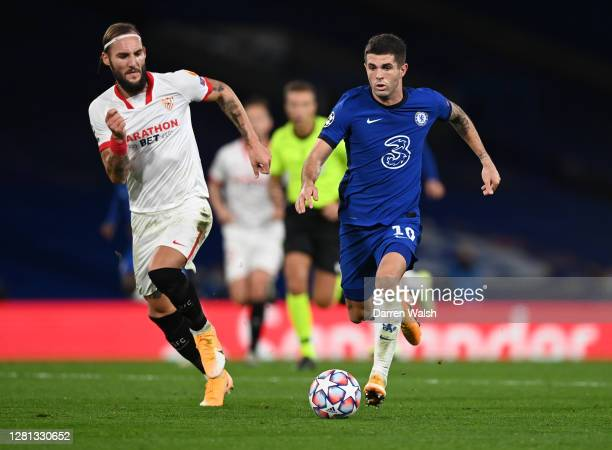 Christian Pulisic of Chelsea is challenged by Nemanja Gudelj of FC Sevilla during the UEFA Champions League Group E stage match between Chelsea FC...