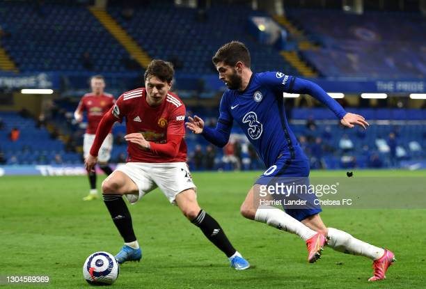 Christian Pulisic of Chelsea is challenged by Victor Lindelof of Manchester United during the Premier League match between Chelsea and Manchester...