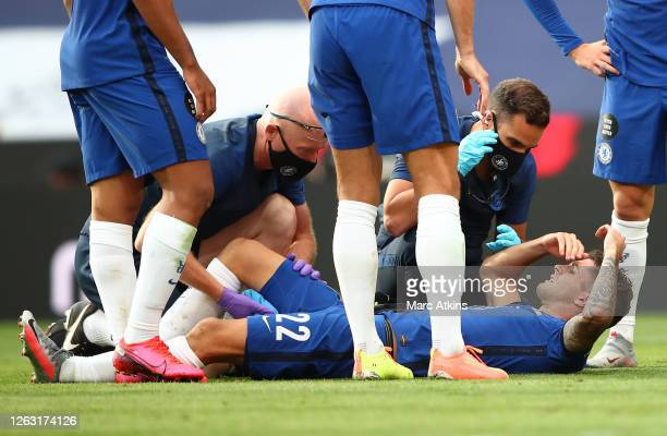 Christian Pulisic of Chelsea receives medical treatment after a hamstring injury during the FA Cup Final match between Arsenal and Chelsea at Wembley...