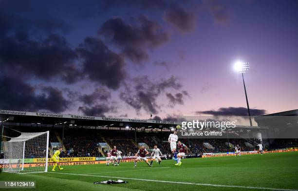 Christian Pulisic of Chelsea rises for a header as the sun goes down during the Premier League match between Burnley FC and Chelsea FC at Turf Moor...