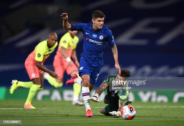Christian Pulisic of Chelsea runs with the ball around Ederson of Manchester City during the Premier League match between Chelsea FC and Manchester...