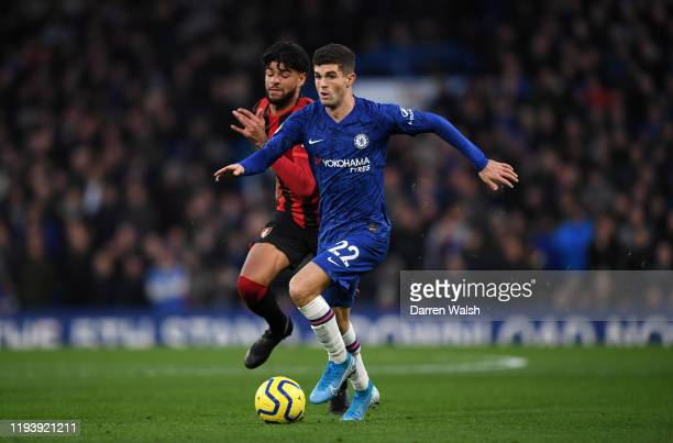 Christian Pulisic of Chelsea runs with the ball under pressure from Philip Billing of AFC Bournemouth during the Premier League match between Chelsea...