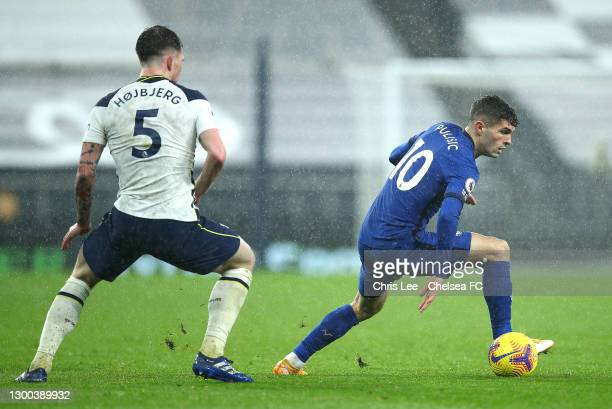 Christian Pulisic of Chelsea runs with the ball under pressure from Pierre-Emile Hoejbjerg of Tottenham Hotspur during the Premier League match...